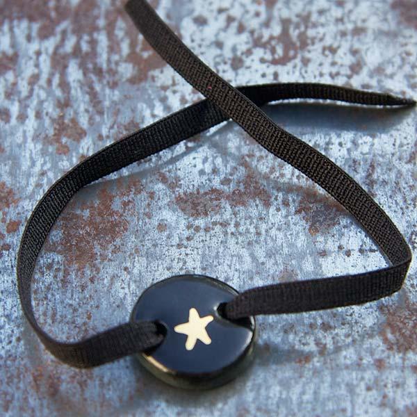 Bracelet émail noir étoile or