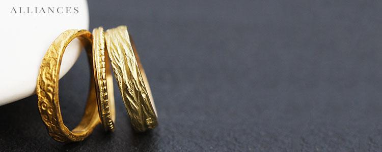 Alliances en or, argent, diamants, pierres fines